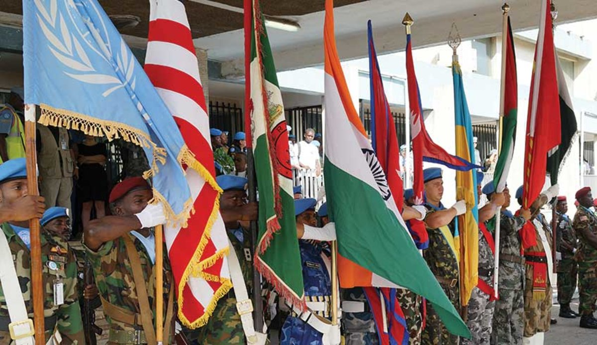 Contingents display flags on 2015 UN Peacekeepers' Day in Monrovia