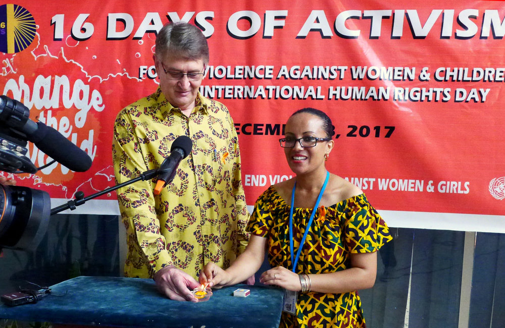 Deputy Special representative of the Secretary-General, Vademar Wrey and Tikel Alemu, UN Women representative lighting a candle on symbolism of 16 days of activism for no violence against women & children and Human Rights day ©UNMIL Photo: Shpend Berbatovci