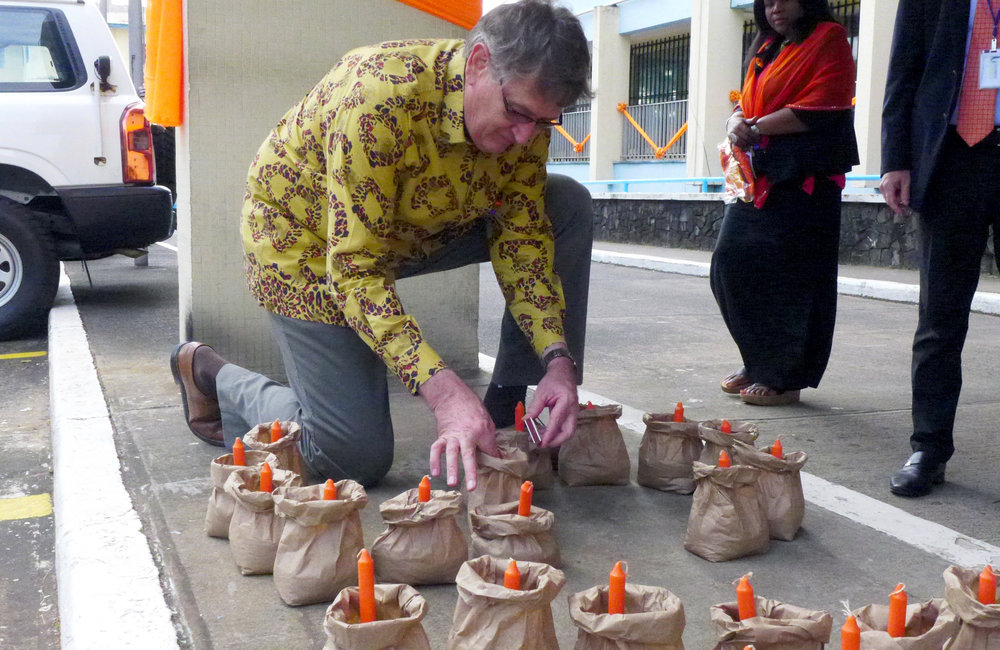 Deputy Special representative of the Secretary-General, Vademar Wrey lighting a candle on symbolism of 16 days of activism for no violence against women & children and Human Rights day ©UNMIL Photo: Shpend Berbatovci