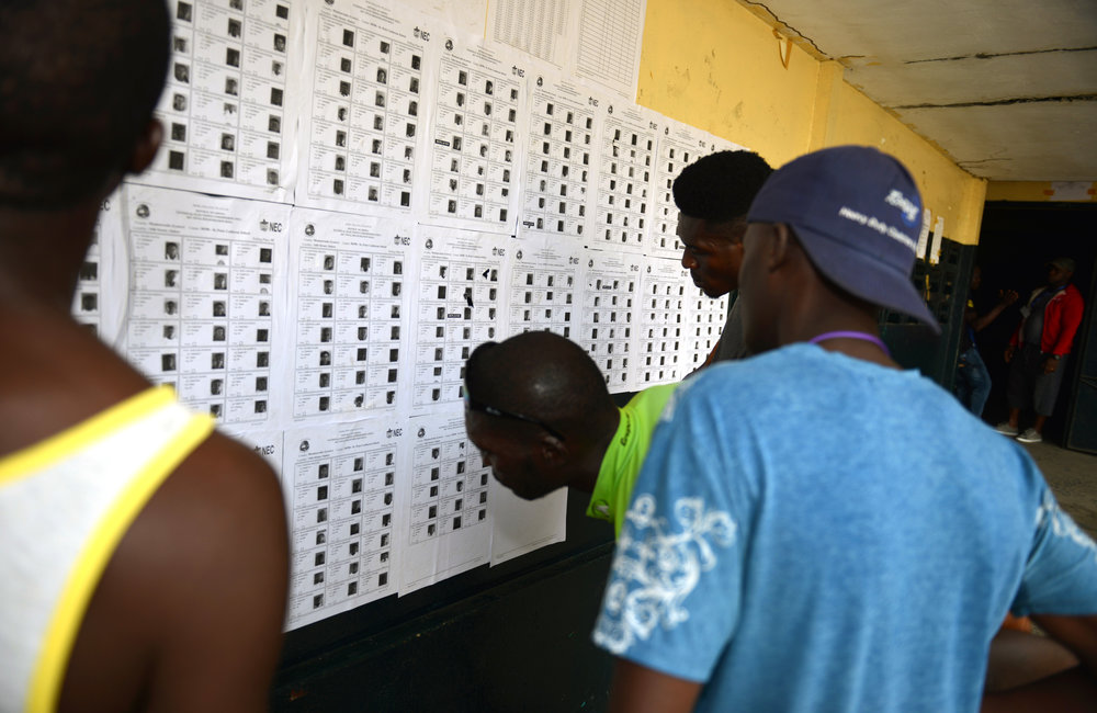 26 December 2017, Presidential Runoff Election Voters looking for their information in a voter precinct.  ©UNMIL Photo: Shpend Berbatovci