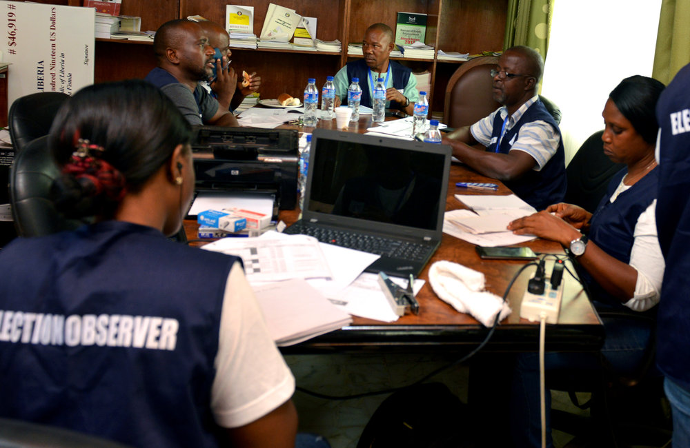 26 December 2017, Presidential Runoff Election ECOWAS situations room staffers on duty. ©UNMIL Photo: Shpend Berbatovci