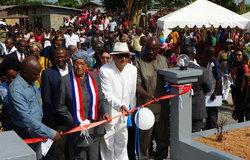Special Representative of the Secretary-General and Head of UNMIL (SRSG) Farid Zarif and President Ellen Johnson-Sirleaf cutting the inaugural ribbon of Du-Port Road Community Memorial Site